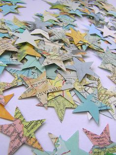 Easy confetti out of old or unused maps!!! You could also do heart or any other type of scrapbooking punch!