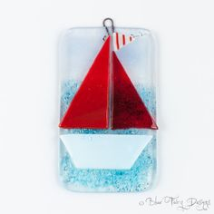 Pretty little hanging featuring a gorgeous little brightly coloured sailboat with one plain and one patterned sail. Different colours available,