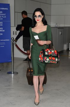 Dita Von Teese gives us a lesson in airport style. Click to shop her outfit and discover other ways to travel in #style.