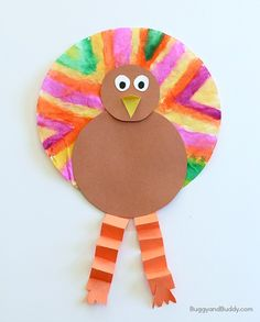 Thanksgiving crafts for kids: Create one psychedelic turkey with this Coffee Filter Turkey Craft. | Buggy and Buddy