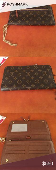 """LV Insolite Organizer (discontinued) Authentic Insolite organizer Wallet, in very good condition, no odors, there is a little wear where the D-ring connects in the wallet, everything else is in very good condition. CHAIN DOES NOT COME WITH WALLET I just put it on there to give you a visual for using it as a wristlet or clutch. Can hold an iPhone 6 Plus or 7 plus in large zippered compartment. SERIOUS BUYERS ONLY PLEASE.  Measures 9"""" in length and 5"""" in height. Comes with original receipt but…"""