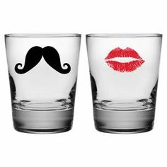 """Set of 2 double old fashioned glasses with silkscreened mustache and lipstick kiss details. Made in the USA.   Product: 2-Piece old fashioned glass setConstruction Material: GlassColor: Clear, black, and redFeatures:  Made and decorated in the USA13.25 Ounce capacity each Dimensions: 4.5"""" H x 3.63"""" Diameter eachCleaning and Care: Dishwasher safe"""
