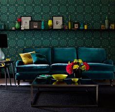 deep emerald sofa used in home decor based off of jewel tones