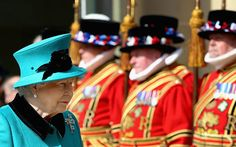 Queen Elizabeth II walks past Yeomen as she leaves Sheffield Cathedral after the traditional Royal Maundy Service at Sheffield Cathedral on April 2, 2015