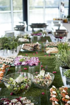 love the real grass table covering with clear serving pieces on top.