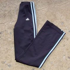 Black and pale blue Adidas form fitting pants Size small. Dark grayish/black color with pale blue stripes. Waist (laid flat) measures 11 inches (with stretch/room for give) and inseam measures 30 inches. 80% polyester and 20% cotton. Worn only a handful of times, washed and in great condition! Feel free to ask me any questions😊* model pic doesn't reflect true color of baby blue stripes! Adidas Pants Track Pants & Joggers