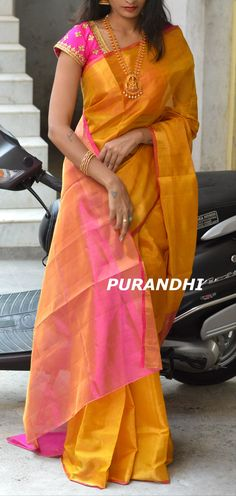 Beautiful yellow and pink color combination pattu saree with pink color designer blouse. Blouse with floral buti design hand embroidery kundan work.  20 March 2018