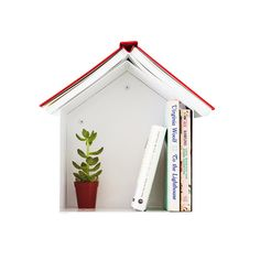 This handy wall-mounted shelf is a charming book holder and recharging station.