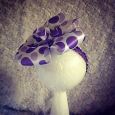 Cute purple headband with polka dots made out of ribbon.