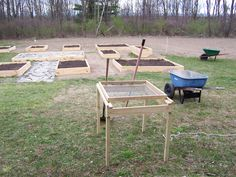 Rock sifter, looks like 2x2 legs, the rest looks like 1x4 and 1x2.  Also nice raised bed layout in background.