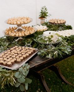 Unlike most couples, Colby and John weren't too concerned about the wedding cake—they were more excited about the mocha ice cream cookie sandwiches that were served as dessert! However, for cake-cutting purposes, they bought one from the grocery store and jazzed it up with the day's signature posies. The sweet treats, which were decorated with olive branches, silver dollar, and seeded eucalyptus were laid out for everyone to feast their eyes on.