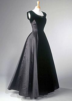 A black velvet and duchesse satin evening gown by Norman Hartnell, made for the Queen in the late 1940s.