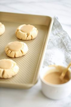 When I think fall, salted caramel immediately comes to mind. Maybe it's the candy apples my mom always gave us for a special treat as we approached the season or that my salt craving goes up as the temperature goes down, but I can't get enough of it. I baked you a thick, soft, chewy sugar cookie, topped with a beautiful pool of salted caramel icing to kick off fall in the name of Fall Cookie Week with my friend Michael of Inspired by Charm. You can catch up here. But for now, let'...