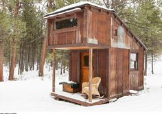 Behind my dream house would be a tiny house, either for guests or for an office: Potomac Cabin, made with reclaimed materials.