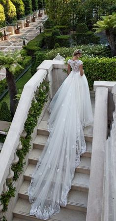 Glamorous short sleeve tulle ballgown wedding dress with royal bridal train; Featured Dress: Alessandra Rinaudo