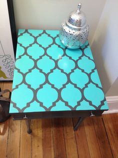 A DIY stenciled side table using the Casablanca Stencil pattern in turquoise. http://www.cuttingedgestencils.com/allover-stencils.html