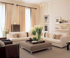 beige sofas grey ottoman and wood accents