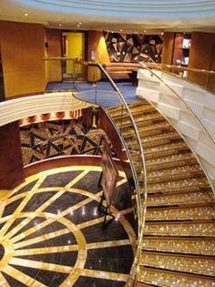 Yacht interior. Golden staircase