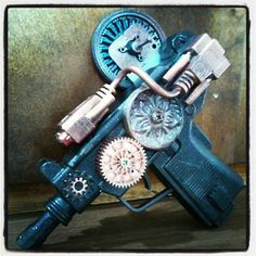 Steampunk Gun Steampunk Handgun Steampunk Machine Gun with Sounds and Salvaged Parts. $34.99, via Etsy.