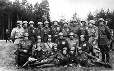 The command echelon of the 144th Regiment, 49th Guards Rifle Division, poses for a victory group portrait somewhere in Austria in May 1945. Note how several of the officers sport German steel helmets. According to veterans of the regiment, the reason for the change in the dress code was that the regiment's supply of helmets was very short.
