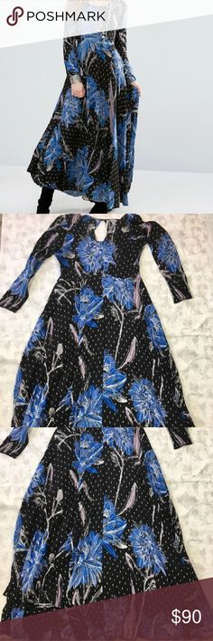 Free People Maxi Dress First Kiss Botanical Night Pre-Loved Condition See Pictures  Good overall condition Shows some wear Has a snag on the back in the skirt. Hard to notice when wearing.  (See last picture)  Chest: 20 inches across Free People First Kiss Maxi Dress Botanical Night SIZE LARGE   The gathered waist of this print maxi dress provides add swing to the long sleeve silhouette.  - Scoop neck - Long sleeves - Back button-and-loop closure - Allover print - Lined from below bust to…