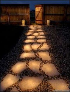 "Line a pathway with rocks painted in glow in the dark paint. During the day they ""charge"" in the sun and in the evening they reflect the stored light. Rust-Oleum Glow in the Dark Brush-on Paint. Totally want to try this!"