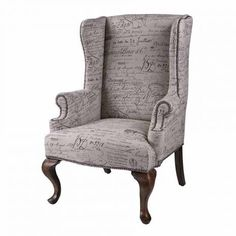 French Script Wingback Armchair with Nickel Nailhead Trim  This wing chair gives one the feeling of owning a well-loved heirloom. Fabric is a linen cotton blend displaying antique french script. Warm mahogany queen ann legs. Throw into a contemporary or transitional room to add warmth and coziness.