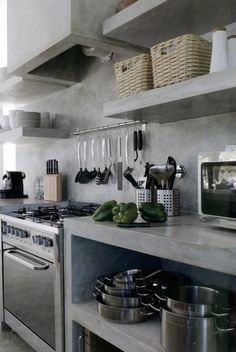 concrete kitchen so industrial lots of open shelving - Industrial Kitchen