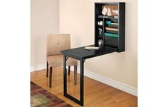 Wall-mounted fold out desk.  Clever for small, multi-functional spaces.  Reasonably priced too!  Modern desks by Design Solutions