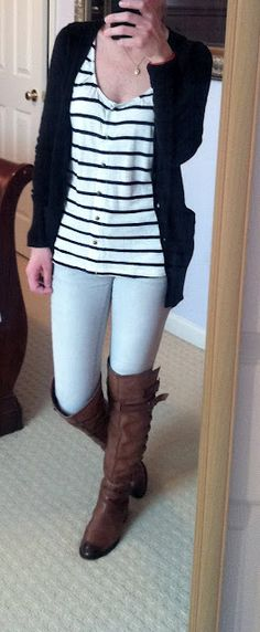 .Black cardigan, black and white striped shirt, grey skinny jeans, brown boots.