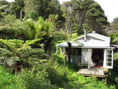 "A ""bach"" on the edge of Hokianga Harbour in Northland, New Zealand.   A bach is a small, often very modest holiday home or beach..."