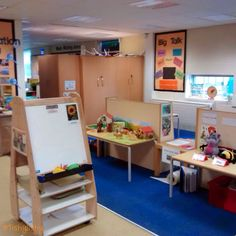 Easel, small world and Jolly Phonics table. Aug 2014
