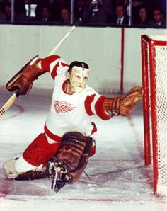 Terry Sawchuk. ... Hap Holmes, Alex Connell, Normie Smith, Tiny Thompson, Glenn hall, Hank Bassen, Johnny Mowers, Harry Lumley, Roger Crozier ... all wore #1 for DET. Wings retired #1 for Sawchuck. 14 of 21 BHL seasons with DET. 3 Vezinas, 3 Cups (another with TOR) Career GAA 2.46. HOF. 'nuf said.