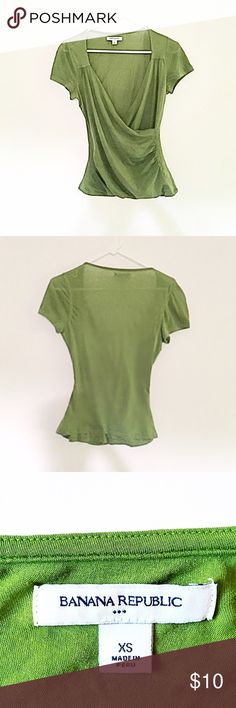Green top This top is super cute and elegant. The ruching at the sides give it a feminine flair. Looks great with a lacy cami underneath. Preloved, but no noticeable rips, stains, or tears. 92% pima cotton 8% lycra. I accept offers! Banana Republic Tops