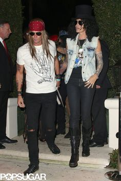 Cindy Crawford and Rande Gerber as Slash and Axl Rose