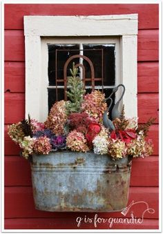 I have several window boxes at my house. It can be a little pricey to fill them up each season, so I've learned to use dried flowers from my perennial gardens…