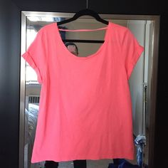 Pink top with low open back Only worn once. No flaws almost new PINK Victoria's Secret Tops