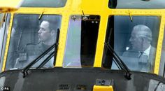 The Duke of Cambridge shows the Prince of Wales one of the Sea King helicopters, as Prince...