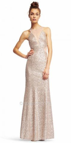 Shine bright like a diamond at your next event in this Fully Sequined Illusion Inset Column Evening Dress by Aidan from Aidan Mattox. This must have style includes an illusion neckline with matching illusion side insets and a fully sequined shimmering body. This style has a subtle flare skirt in the shape of a column silhouette. #edressme