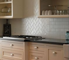 Stunning Cool Tips: Stone Subway Tile Backsplash herringbone backsplash kitchen.How To Install Beadboard Backsplash large marble backsplash.How To Install Beadboard Backsplash. Stove Backsplash, Kitchen Countertops, Kitchen Cabinets, Backsplash Ideas, Backsplash Design, Subway Backsplash, Copper Backsplash, Beadboard Backsplash, How To Tile Backsplash