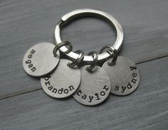 Choose one to five 5/8 round sterling silver discs each hand stamped with one name around the edge. They are brushed to a distressed, matte finish (may be hard to see in photos) and connected to a flat, high quality stainless steel key chain (30 mm). This makes a wonderful gift for mom, dad, grandma or grandpa!  My hand stamped items will have slight variations in alignment, spacing and depth as these items are stamped by me, not by a machine. This adds to the charm and uniqueness of these…