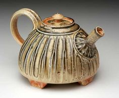 Porcelain teapot in carbontrap shino