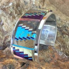 This beautifully designed Multi-Stone Inlay Sterling Silver Cuff Bracelet is created and handcrafted by Navajo Artist Tommy Jackson. Colors may vary with computer monitor Stone: Sleeping Beauty Turquo