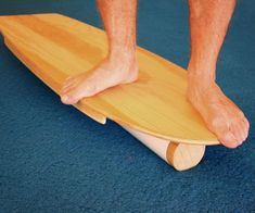 Rail-to-rail balance boards have a long roller that goes down the length of the board, which more accurately simulates a surfboard trimming across a wave face. Skate Shape, Skate Longboard, Surfboard Storage, Wooden Surfboard, Surf Training, Sup Boards, Standup Paddle Board, Sup Surf, Learn To Surf