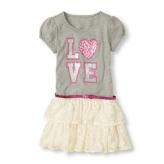 Glitter graphics on soft tee material with a flouncy lace skirt - you can