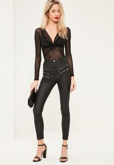 Mesh around during the party season wearing this beaut' bodysuit in black - featuring long sleeves, a v neckline and twist details.
