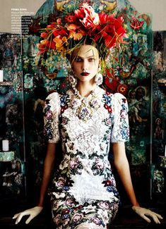 Not sure why Agnes is all dressed up like this...I think she thinks she is Ms. Flowerhat.........      by Mario Testino