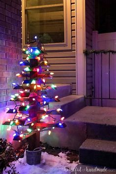 Use up scraps of 2x4s to make these fun wood Christmas trees. They are easy to make and add extra Christmas cheer to your front porch. Housefulofhandmade.com #ChristmasTree #DIY #WoodenChristmasTree Porch Christmas Tree, Christmas Lights Outside, Diy Christmas Lights, Decorating With Christmas Lights, Christmas Gift Decorations, Christmas Tree Ornaments, Christmas Diy, Outdoor Christmas Trees, Christmas Garden