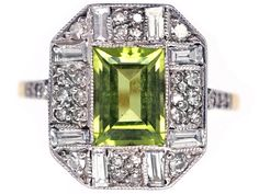 An unusual and very well designed Art Deco ring. It is set with a central rectangular peridot that is surrounded with eight diamond bagettes interspersed with smaller diamonds. It also has diamonds set in the shoulders. The top is platinum and the shank is 18ct gold. It is in excellent condition and would make a …