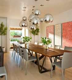 Sensational Tom Dixon decorating ideas for Delightful Dining Room Mediterranean design ideas with artwork blond blond wood floor blonde wood Chrome Balls gray leather side